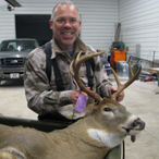 Man with Trophy Buck