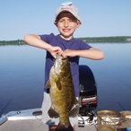 Kid holding smallmouth bass